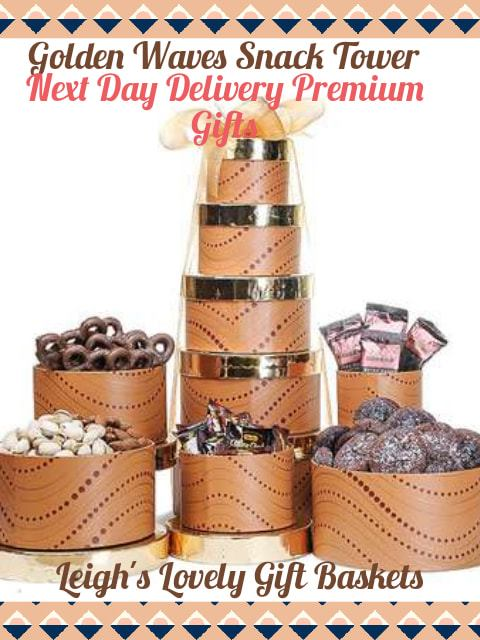 Elegant round tower gift boxes are decorated with a wave pattern, have gold lids and trimmed with a gold bow. Tower boxes are filled with a marvelous assortment of Brix Chocolates, Chocolate Covered Mini Pretzels, Bali's Best Coffee Candies Pistachios and Almonds and Salted Caramel Chocolate Cookies