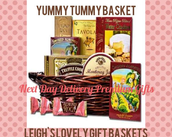 Dark stained gift basket is filled with a delightful assortment of gourmet snacks including Three Pepper Water Crackers, Snack Mix, Smoked Almonds,  Almond Rocca, Chocolate Truffle Cookies,  and Sonoma Jack Monterey Jack Cheese