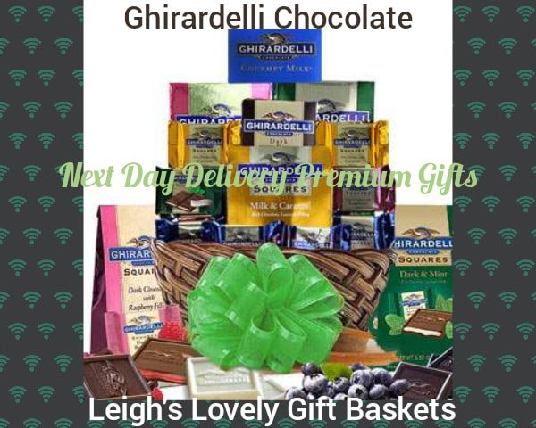 Large round woven basket holds a delectable assortment Ghirardelli Dark and Raspberry, Milk and Caramel, Mint and Dark Chocolate Squares, Milk Chocolate  Squares, a Creamy Devotion Bar 32% Cacao, and a  Dark and Caramel Bar