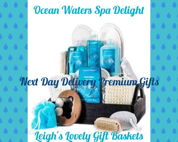 Handsome black handled tray basket is filled with soothing Ocean Waters Bath Salts,   Shower Gel ,Body Lotion ,Body Loofah  Slippers and Pumice Stone