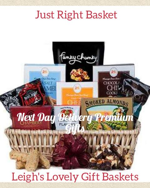 Natural woven basket with ribbon bow is filled with a variety of delicious treats for snacking. Includes Sea Salt Caramel Popcorn, Cheese Straws,Chocolate Chip Cookies,  • Sea Salt Caramel Cookies, Sea Salt and Caramel Balls,   Chamberry Raspberry Truffles,  Smoked Almonds,  Jelly Belly Assorted Flavors, and Rebel Peanuts
