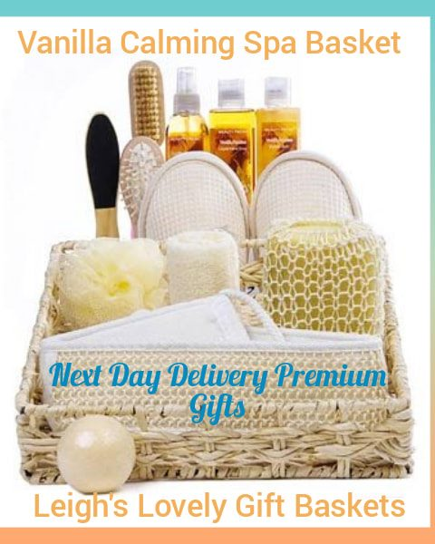 Beautiful woven basket holds gifts to pamper her from slippers to a loofah and brushes, vanilla scented bubble bath, vanilla shower gel, vanilla spray, and a bath bomb.