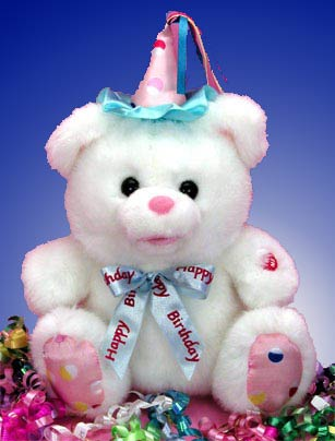 Adorable white  12 inch sitting bear  wears a pink and blue party hat and blue ribbon with Happy Birthday sings the birthday song.