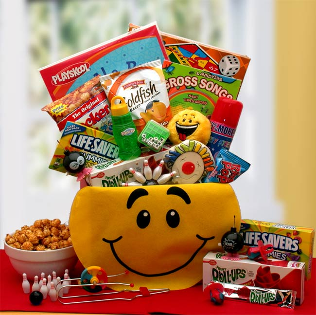 Smiley Face Gift Box is filled with Playskool doodle pad, children's board game (assortments include checkers chutes and ladders Bingo), Annoying and Gross Songs CD for Kids with activity book, silly string, word jumble puzzle cube game, miniature hopping and popping bombs, finger bowling game, smiley face kick ball, and sweets.