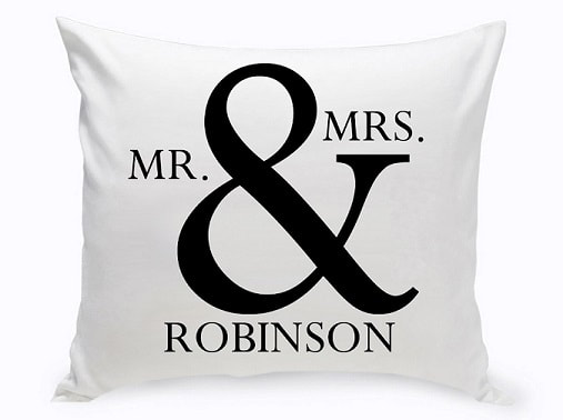 Couples Throw pillow features a bold (and) symbol accompanied by the couple's last name. Standing out in a nice black and white palette.
