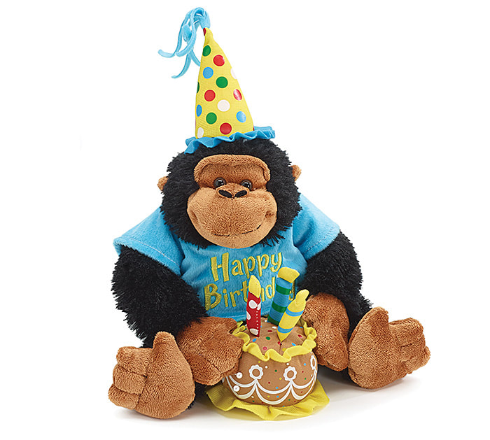 "12 inch Black and brown monkey wears a polka dot party hat and blue tee shirt with ""Happy Birthday"" .Monkey is holds a cake with 3 candles on top and plays Happy Birthday Song."
