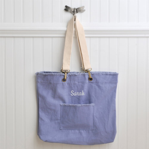 Washed cotton tote has a youthful and sturdy design with handsome brass hardware and accents. A  comfortable double strap makes it easy to carry on your shoulder